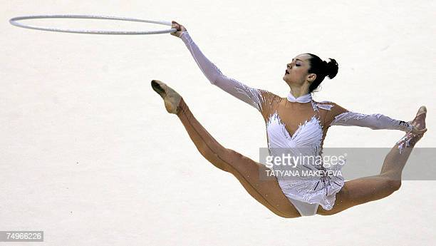 Ukraine's Anna Bessonova performs with the hoop during a group A event at the 23rd European Rythmic gymnastics championship in Baku 30 June 2007 The...