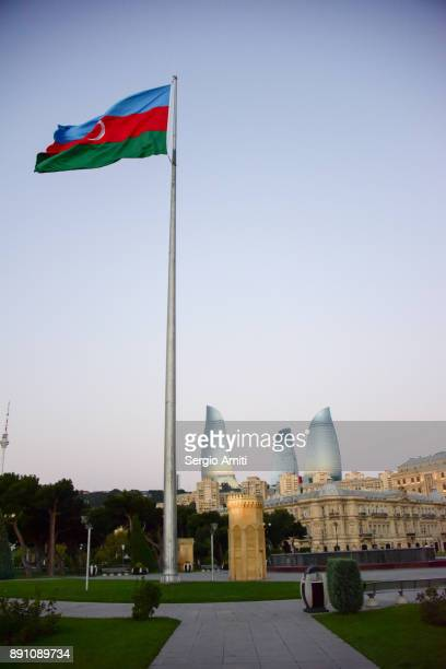 baku national flag square with the flame towers at sunrise - flagpole sitting stock photos and pictures