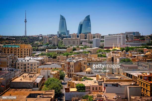 baku old town with flame towers in the background, azerbaijan - azerbaijan stock pictures, royalty-free photos & images