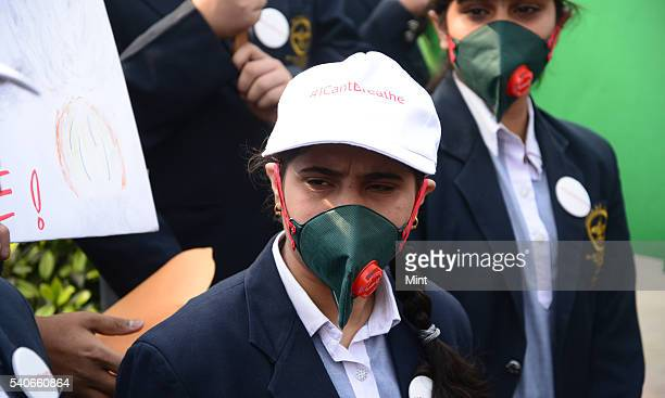 Bal Bharati Public school children Pitampura wearing anti pollution masks during anti pollution drive to promote Oddeven Vehicle Rationing scheme at...