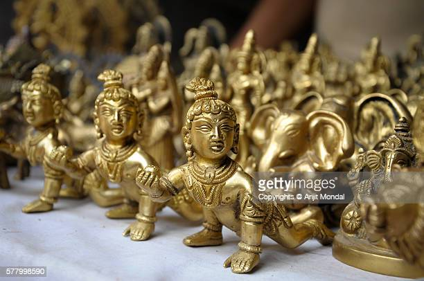 bal gopal idols in brass metal for sell also called little krishna - lord krishna stock photos and pictures