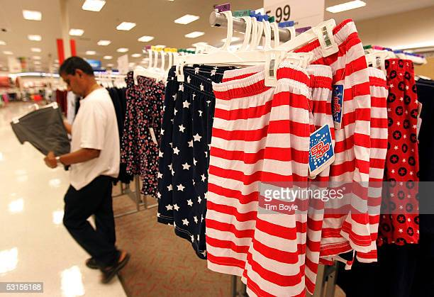 Bal Parikh walks past a display of US flag Fourth of Julythemed boxer shorts at a Target store June 27 2005 in Rosemont Illinois Consumers are...