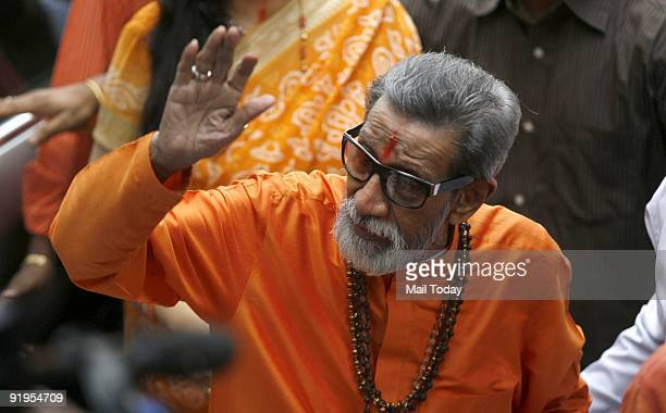 Bal Thackeray chief of the right wing Hindu party Shiv Sena waves towards the media as he arrives to cast his vote at a polling centre during the...