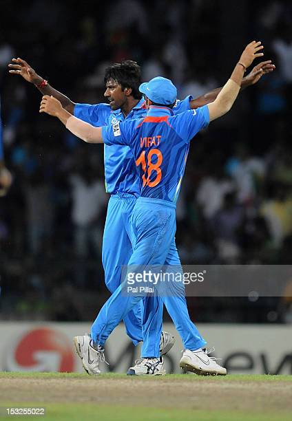 Balaji of India celebrates the wicket of J P Duminy of South Africa with teammate Virat Kohli during the ICC World Twenty20 2012 Super Eights Group 2...