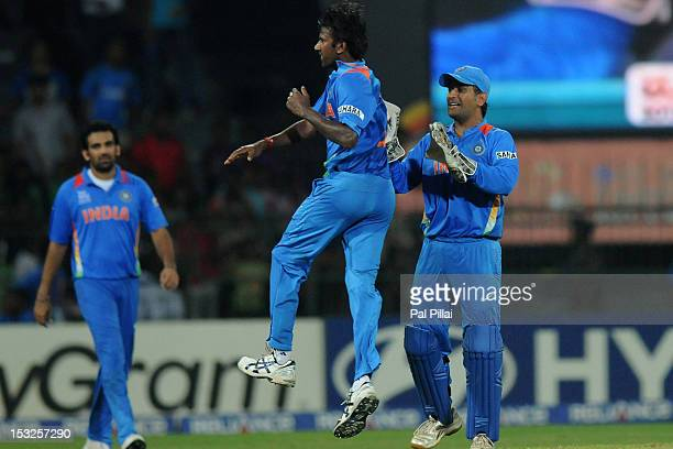 Balaji of India celebrates the wicket of Morne Morkel of South Africa with team captian M S Dhoni during the ICC World Twenty20 2012 Super Eights...