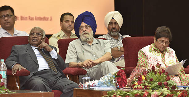 K G Balakrishnan Chief Justice Supreme Court Charanjit Singh Atwal Speaker Punjab Vidhan Sabha along with Puducherry Lt Governor Kiran Bedi during...