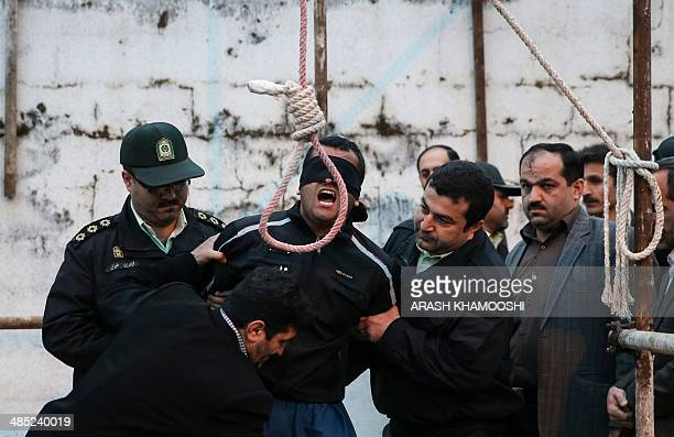 Balal who killed Iranian youth Abdolah Hosseinzadeh in a street fight with a knife in 2007 is brought to the gallows during his execution ceremony in...