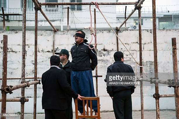 Balal who killed Iranian youth Abdolah Hosseinzadeh in a street fight with a knife in 2007 reacts as he stands in the gallows during his execution...