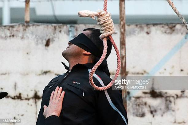 Balal who killed Iranian youth Abdolah Hosseinzadeh in a street fight with a knife in 2007 is pictured blindfolded next to a noose during his...