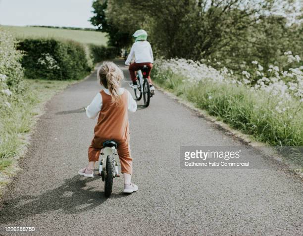 balance bike - life events stock pictures, royalty-free photos & images