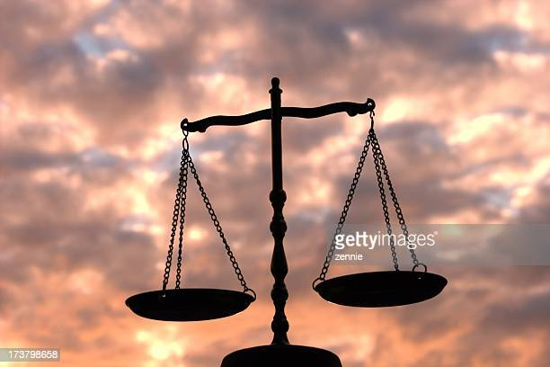 balance scale against multi-colored sky - morality stock pictures, royalty-free photos & images