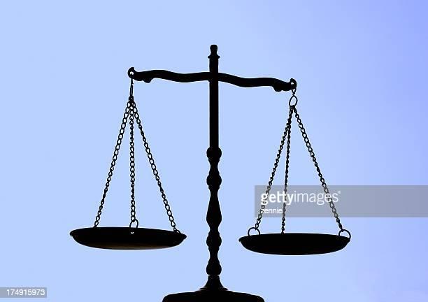 Balance Scale On Blue Background