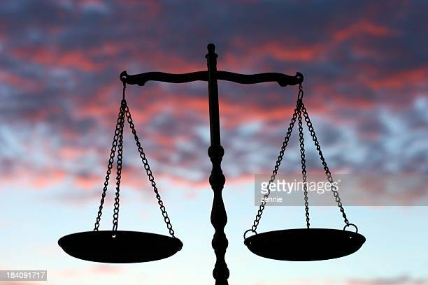 Balance Scales Against Evening Sky