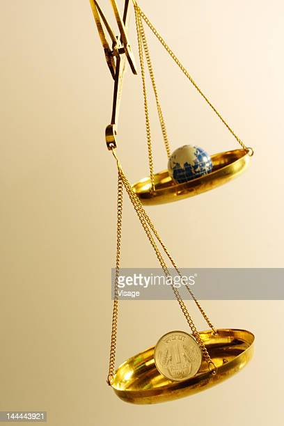 A balance with money and globe