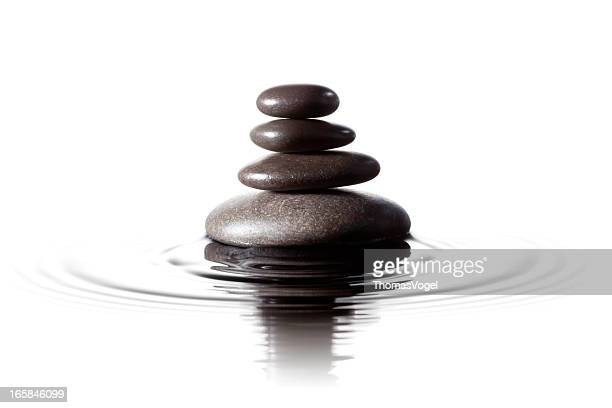 Balanced black stones in water - Feng Shui Massage Lastone