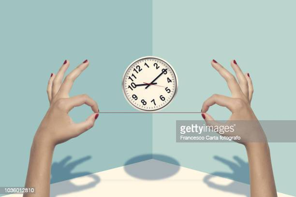 balanced life - wall clock stock photos and pictures