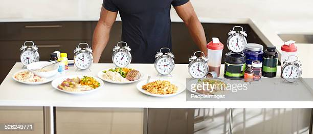 balanced meals with structured mealtimes is a must - sportsperson stock pictures, royalty-free photos & images