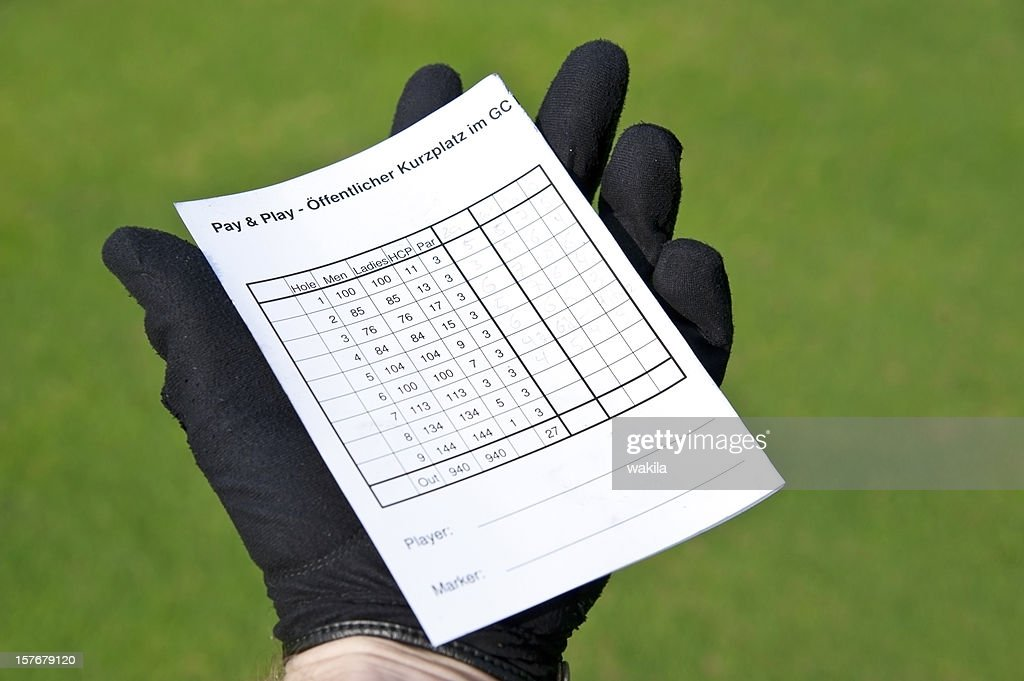 balanced scorecard - holding golf card in hand with gloves : Stock Photo