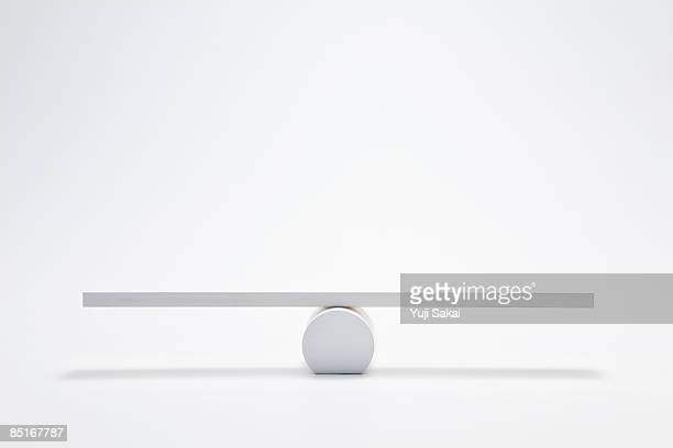balanced seesaw - balance stock pictures, royalty-free photos & images