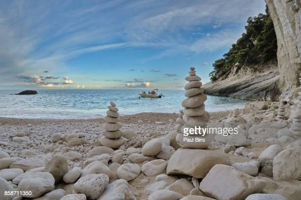 Balanced stones on a pebble beach during sunset, Zakynthos, in the Ionian Islands of Greece