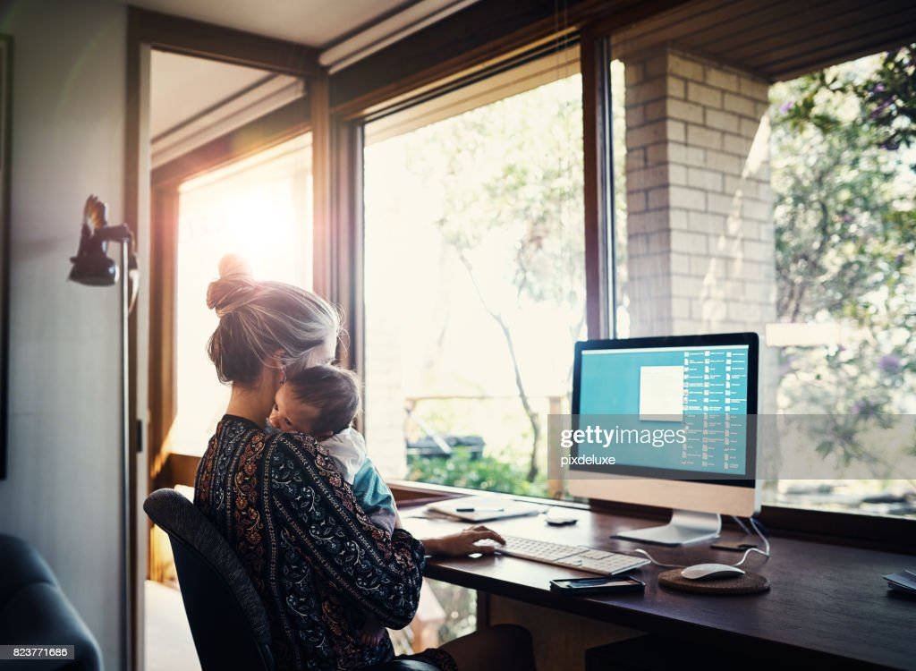 Balancing a new business and a new baby : Stock Photo