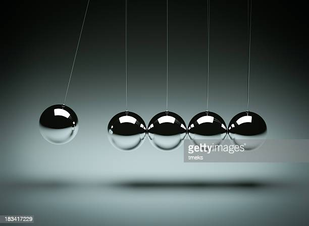 balancing balls newton's cradle - burden stock pictures, royalty-free photos & images