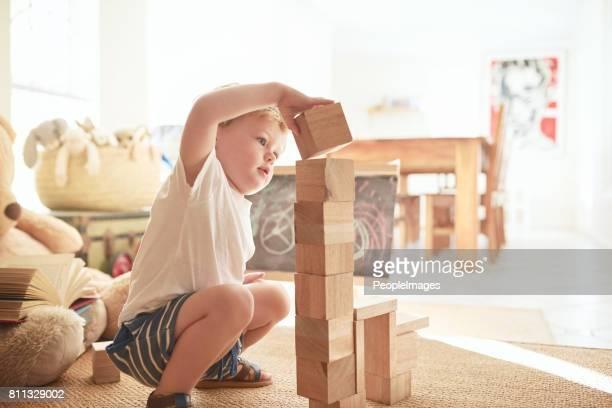 balancing blocks - building blocks stock pictures, royalty-free photos & images