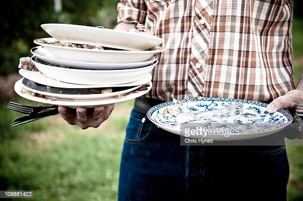 Balancing stacks of dirty dishes to return to the
