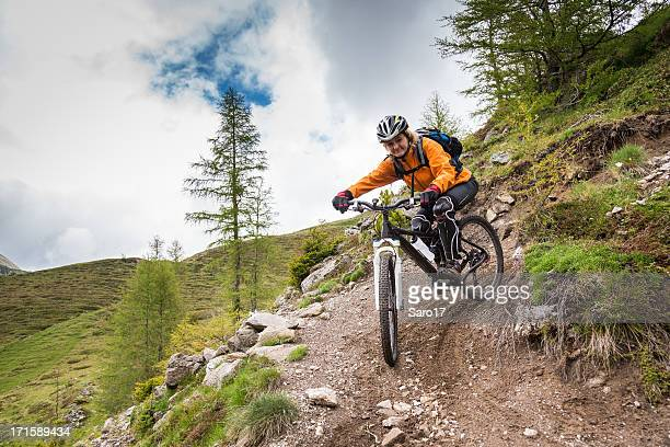 balancing the hairpin curve, carinthia - cross country cycling stock pictures, royalty-free photos & images