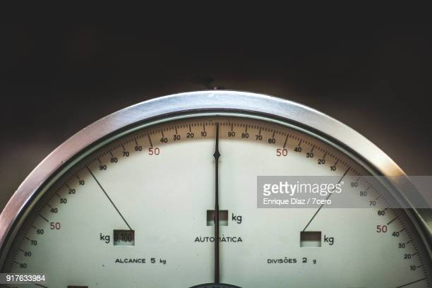 balancing the scales - mass unit of measurement stock pictures, royalty-free photos & images