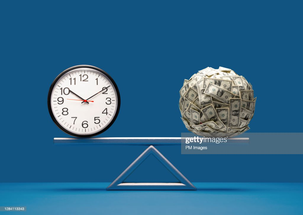 Balancing time and money : Stock Photo