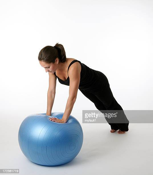 balancing with hands on fitness ball
