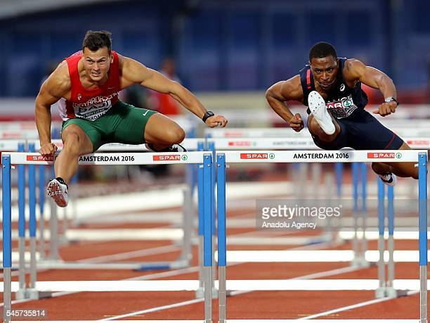 Balazs Baji of Hungary and Wilhem Belocian of France compete in the men's 110m hurdles final at the European Athletics Championships in Amsterdam the...