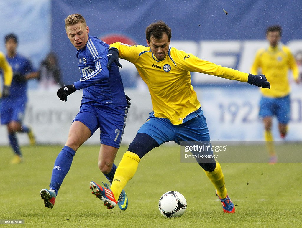Balazs Dzsudzsak of FC Dynamo Moscow is challenged by Danko Lazovic (R) of FC Rostov Rostov-on-Don during the Russian Premier League match between FC Dynamo Moscow and FC Rostov Rostov-on-Don at the Arena Khimki Stadium on March 30, 2013 in Khimki, Russia.