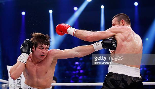 Balazs Kelemen of Hungary exchanges punches with Vincent Feigenbutz of Germany during their WBO intercontinental super middleweight championship...