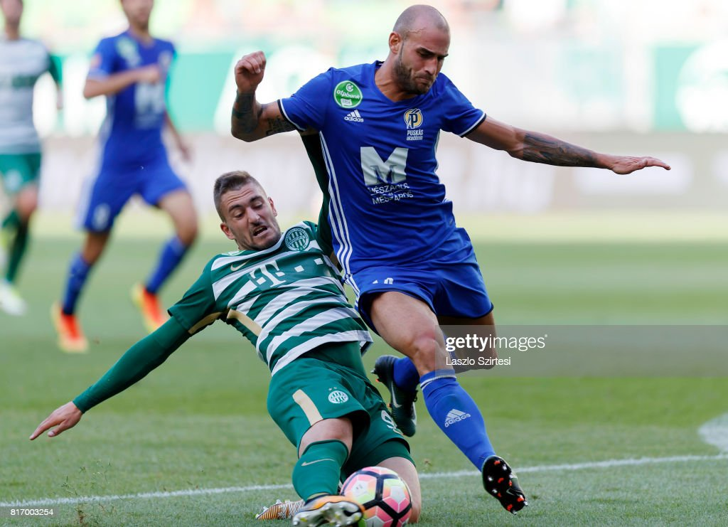 Balazs Lovrencsics (L) of Ferencvarosi TC battles for the ball with Jonathan Heris (R) of Puskas Akademia FC during the Hungarian OTP Bank Liga match between Ferencvarosi TC and Puskas Akademia FC at Groupama Arena on July 16, 2017 in Budapest, Hungary.