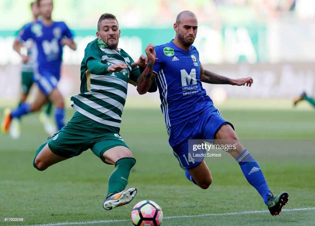 Balazs Lovrencsics (L) of Ferencvarosi TC battles for the ball with Jonathan Heris #14 of Puskas Akademia FC during the Hungarian OTP Bank Liga match between Ferencvarosi TC and Puskas Akademia FC at Groupama Arena on July 16, 2017 in Budapest, Hungary.