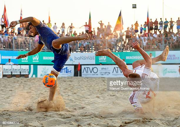 Balazs Rutai of Hungary attempts a scissor kick shot on goal in front Gabriele Gori of Italy during the FIFA Beach Soccer World Cup 2017 Qualifier...