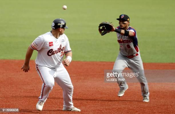Balbino Fuenmayor Caribes de Anzoátegui of Venezuela is out at second base by Gustavo Nuñez Anguilas Cibaeñas of Republica Dominicana during the...