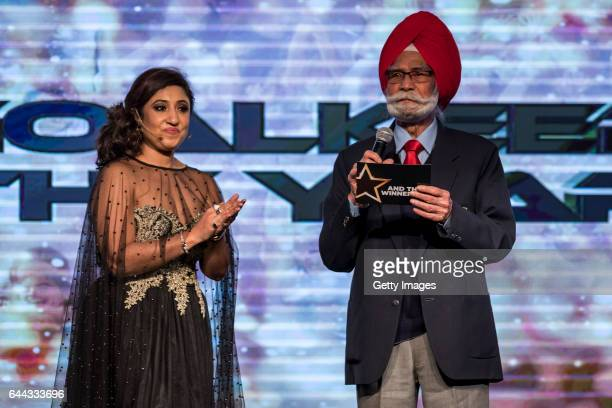Balbir Singh [R] Three Time Olympic Gold Medalist accompanied by compere Sanchalli Arora speaks during the FIH Hockey Stars Awards 2016 at Lalit...