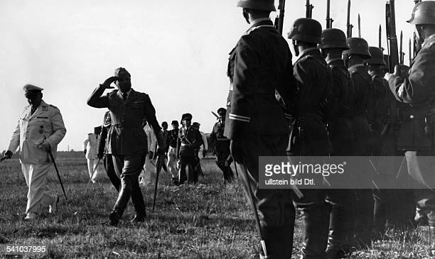 Balbo Italo Politician Italy *05061896* after his arrival at the airport Staaken near Berlin taking the salute of a regiment of air force soldiers...