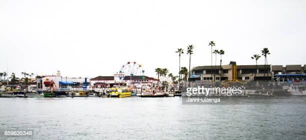 balboa fun zone seen from balboa island, ca - newport beach california stock photos and pictures