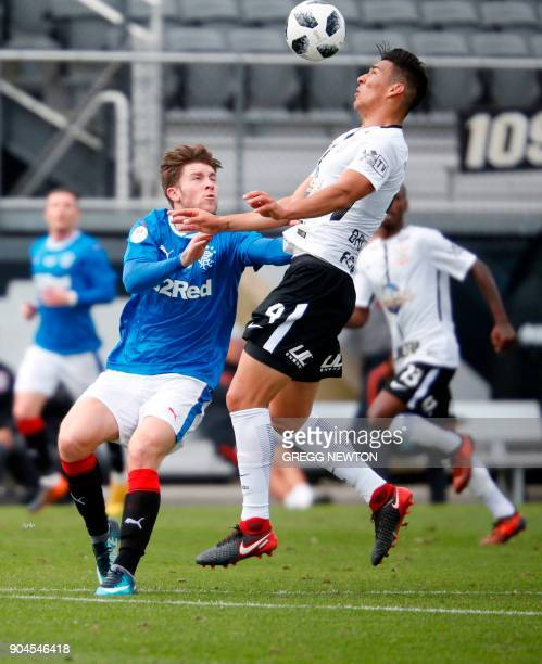 Balbuena of Brazilian club Corinthians clrears the ball away from Josh Windass of Scottish club Rangers FC during their Florida Cup soccer game at...