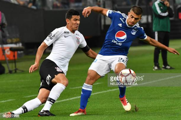Balbuena of Brazil's Corinthians vies for the ball with Jhon Duque of Colombia's Millonarios during their 2018 Copa Libertadores football match held...