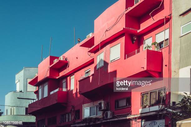 balconies and windows of old historic building - tel aviv stock pictures, royalty-free photos & images
