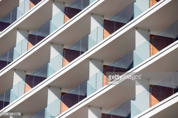 balconies in modern apartment building - construction industry stock pictures, royalty-free photos & images