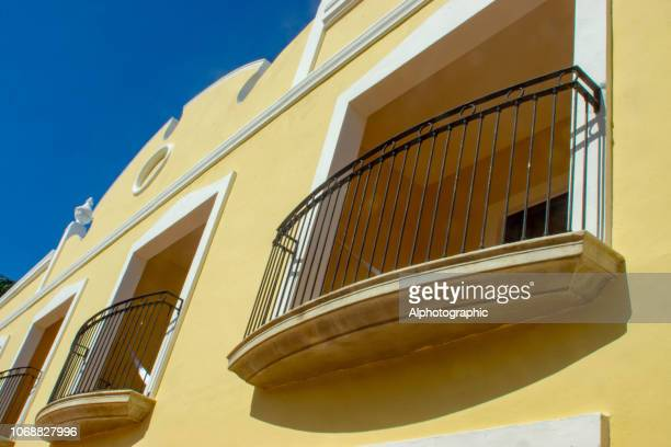 balconies on a high end beach property in mexico - riviera maya stock photos and pictures