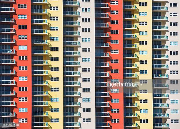 balconies on apartment building - repetition stock pictures, royalty-free photos & images
