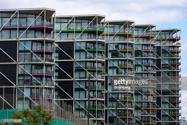 Balconies sit on the exteriors of blocks of flats that make up the the Riverlight residential development in the Nine Elms district in London UK on...