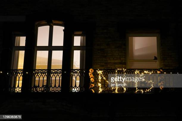"Balcony is decorated with flowers spelling out ""NHS"" during the Clap for Heroes event on January 14, 2021 in Saltburn-by-the-Sea, England. During the..."